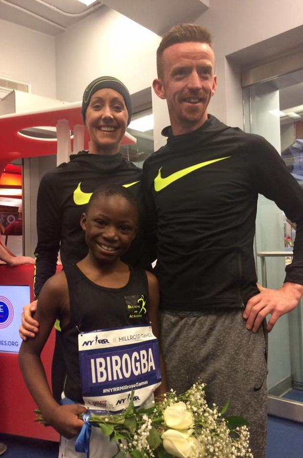 Dermot McDermott and fiancee Caoimhe Ni Mhurchu with a triumphant Bernard Ibirogba from Kildare at last year's Millrose Games