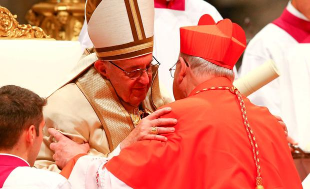 Pope Francis embraces new cardinal Kevin Farrell during a ceremony to install 17 new cardinals at the Vatican in 2016. Photo: Reuters