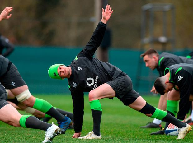 Johnny Sexton goes through a stretching routine during training yesterday ahead of Ireland's departure to Paris. Photo: Matt Browne/Sportsfile