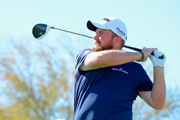 Shane Lowry of Ireland watches his tee shot on the 15th hole during the first round of the Waste Management Phoenix Open