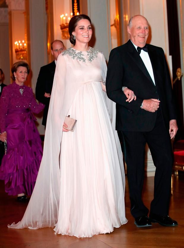 Catherine, Duchess of Cambridge is escorted into dinner by King Harald V of Norway at the Royal Palace on day 3 of her visit to Sweden and Norway with Prince William, Duke of Cambridge on February 1, 2018 in Oslo, Norway. (Photo by Chris Jackson - Pool/Getty Images)