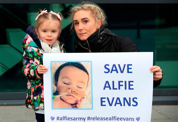 Supporters of Tom Evans and Kate James the parents of 20-month-old Alfie Evans, outside Liverpool Civil and Family Court during a hearing related to their dispute with medics looking after their son at Alder Hey Children's Hospital. Photo: Peter Byrne/PA Wire
