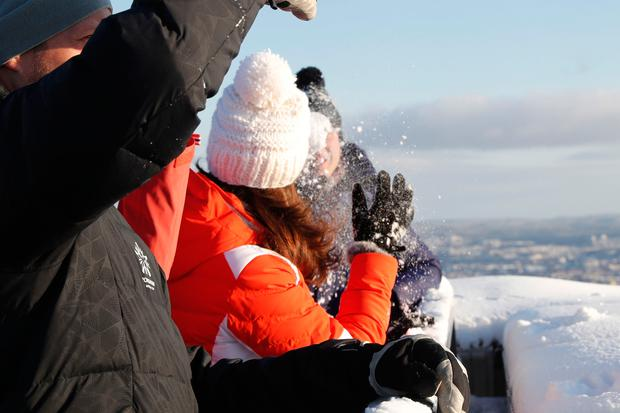 Britain's Kate throws a snowball at Prince William during their visit at Holmenkollen Ski Arena in Oslo, Norway. (Cornelius Poppe/NTB scanpix via AP)