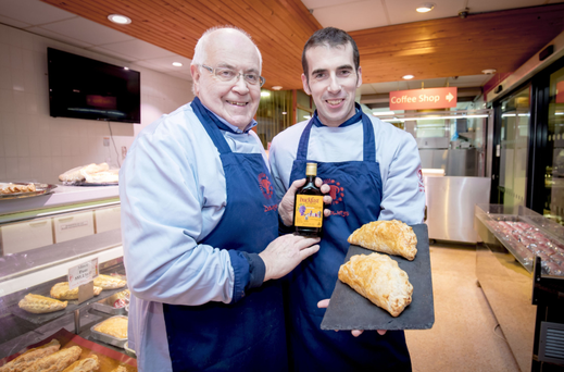 John and Simon Dowey with their Buckfast pasty. Photo: Kevin Scott / Belfast Telegraph