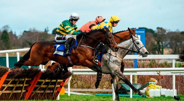 Eventual winner, Tower Bridge, with J J Slevin up, left, jumps the last on their first time round during the Lacy & Partners Solicitors Novice Hurdle during Day 1 of the Dublin Racing Festival at Leopardstown Racecourse in Leopardstown, Dublin. Photo by David Fitzgerald/Sportsfile