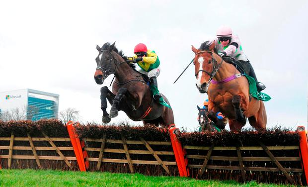 Supasundae and Robbie Power (left) win the BHP Insurance Irish Champion Hurdle from Faugheen during day one of the Dublin Racing Festival at Leopardstown Racecourse