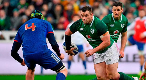 Cian Healy of Ireland passes to Jonathan Sexton during the NatWest Six Nations Rugby Championship match between France and Ireland at the Stade de France in Paris, France. Photo by Ramsey Cardy/Sportsfile
