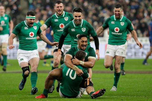 Ireland's fly-half Jonathan Sexton (R) celebrates with Ireland's centre Bundee Aki after scoring a drop goal to win the Six Nations rugby union match between France and Ireland at the Stade de France