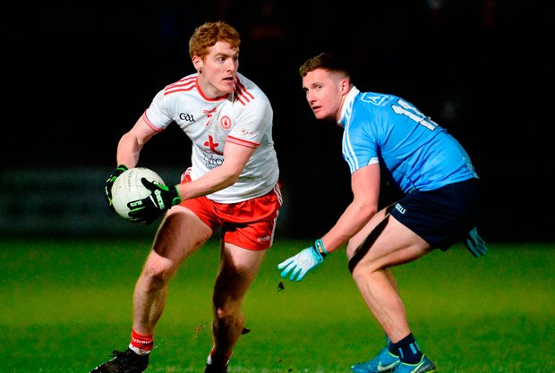 Peter Harte of Tyrone in action against Ciaran Kilkenny of Dublin