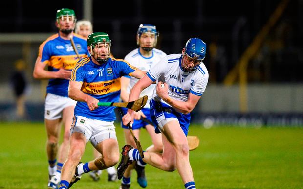 Austin Gleeson of Waterford in action against Noel McGrath of Tipperary