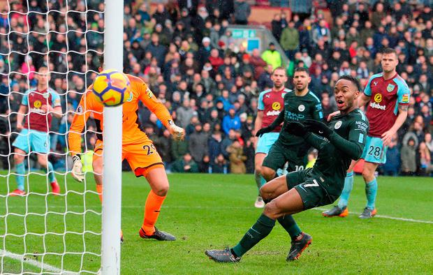 Raheem Sterling reacts as he sees his close-range effort go narrowly wide of the post against Burnley. Photo: Richard Sellers/PA