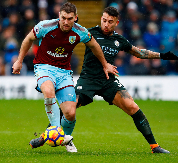 Burnley's Sam Vokes battles with Manchester City's Nicolas Otamendi. Photo: Reuters