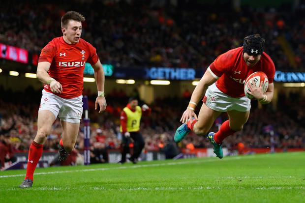 Leigh Halfpenny of Wales supported by Josh Adams dives over to score his second try. Photo: Getty Images