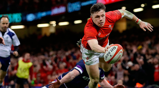 Steff Evans scores a fourth try for Wales at full stretch to seal a bonus-point victory over Scotland in their Six Nations opener at Cardiff yesterday. Photo: Getty Images