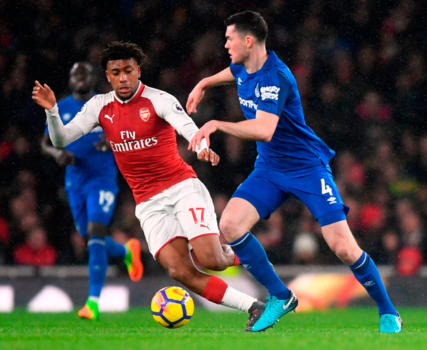 Everton's Michael Keane (right) and Arsenal's Alex Iwobi battle for the ball. Photo Victoria Jones/PA