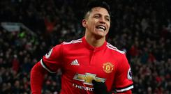 Alexis Sanchez celebrates after scoring his first Manchester United goal. Photo: Scott Heppell/Reuters
