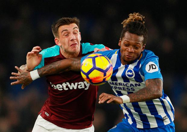 West Ham's Jordan Hugill battles for the ball with Brighton's Gaetan Bong. Photo: Ian Walton/Reuters