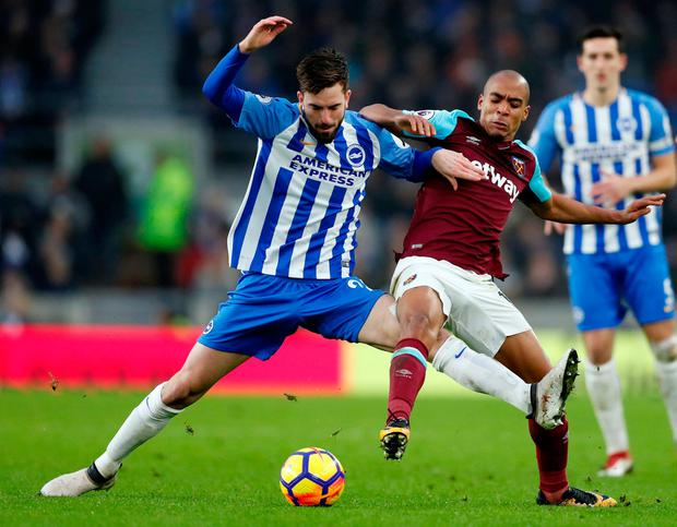 Brighton's Davy Propper in action with West Ham United's Joao Mario. Photo: Matthew Childs/Reuters