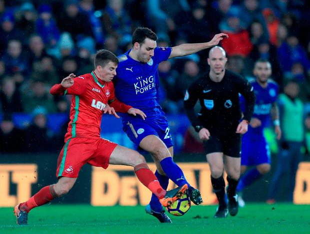Leicester City's Matty James (right) battles for the ball with Swansea City's Tom Carroll. Photo: Simon Cooper/PA