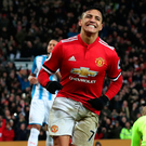 Alexis Sanchez celebrates after scoring Manchester United's winning goal against Huddersfield yesterday. Photo: Scott Heppell/Reuters