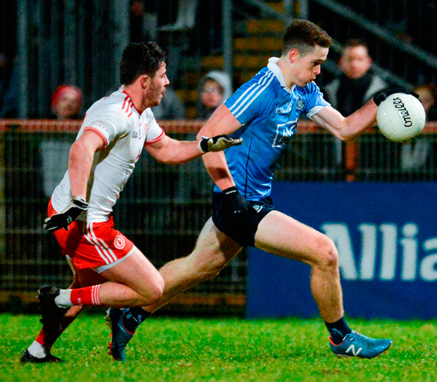 Dublin's Brian Fenton gets past Ciaran McLaughlin of Tyrone in Omagh last night. Photo: Oliver McVeigh. Photo: Oliver McVeigh/Sportsfile