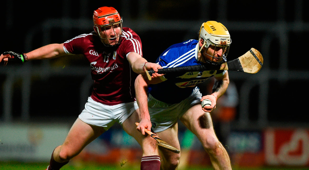 Leigh Bergin of Laois in action against Conor Whelan of Galway at O'Moore Park. Photo: Daire Brennan/Sportsfile
