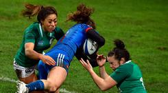 France's center Cyrielle Banet (C) jumps to score a try. Photo: Getty Images