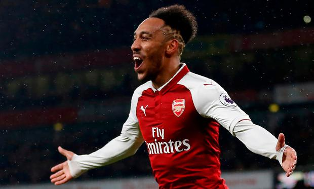 Arsenal's Gabonese striker Pierre-Emerick Aubameyang celebrates scoring his first Arsenal goal