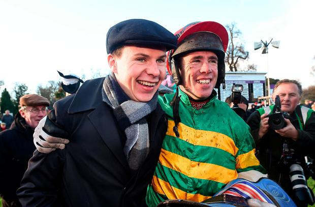 Jockey Derek O'Connor with trainer Joseph O'Brien the parade ring after winning the Unibet Irish Gold Cup on Edwulf during Day 2 of the Dublin Racing Festival at Leopardstown Racecourse in Leopardstown, Dublin. Photo by David Fitzgerald/Sportsfile