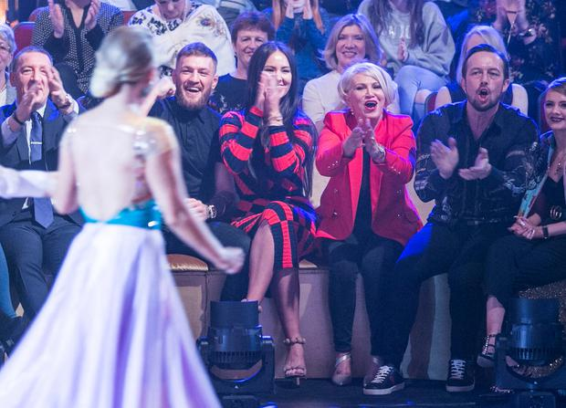 Conor Mc Gregor with his Partner Dee watching his sister Erin ,during the Fifth Live show of RTE's Dancing with the Stars. Photo: Kyran O'Brien