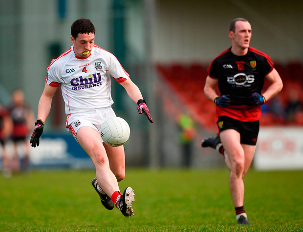 Micheal McSweeney of Cork in action against Shay Millar of Down. Photo by Philip Fitzpatrick/Sportsfile