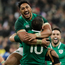 Bundee Aki is the first to embrace Johnny Sexton after his match-winning heroics. Photo: Getty Images