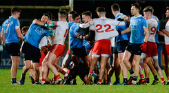 Tyrone and Dublin players lock horns during their clash in Omagh on Saturday night. Photo: Sportsfile