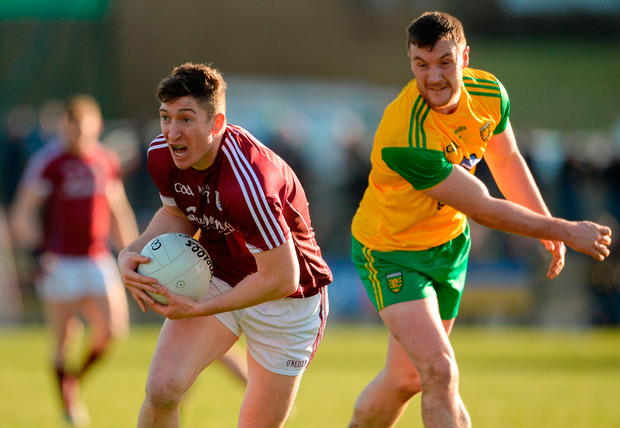Johnny Heaney of Galway in action against Leo McLoone of Donegal. Photo by Oliver McVeigh/Sportsfile