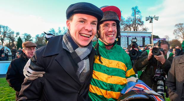 Jockey Derek O'Connor with trainer Joseph O'Brien in the parade ring after winning the Irish Gold Cup on Edwulf. Photo by David Fitzgerald/Sportsfile
