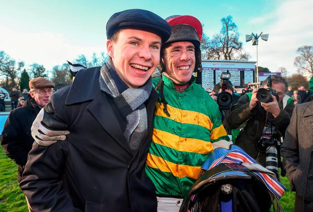 Jockey Derek O'Connor with trainer Joseph O'Brien after winning the Irish Gold Cup. Photo: David Fitzgerald/Sportsfile