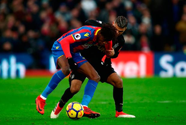 Crystal Palace's Wilfried Zaha (left) and Newcastle United's DeAndre Yedlin. Photo credit: John Walton/PA Wire