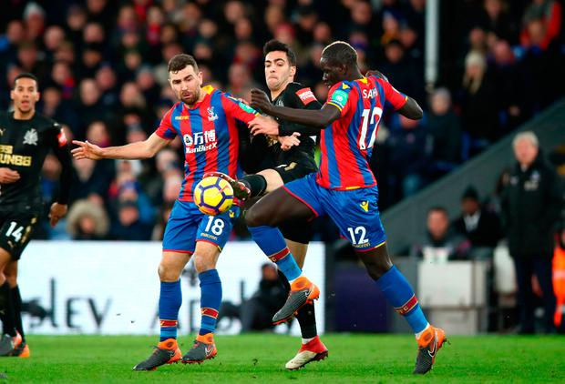 Newcastle United's Mikel Merino (centre) is tackled by Crystal Palace's James McArthur (left) and Mamadou Sakho. Photo credit: John Walton/PA Wire