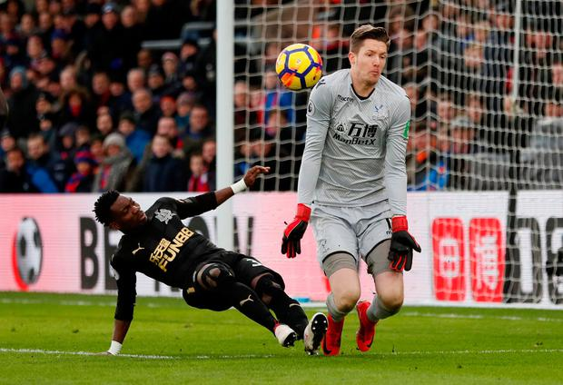 Newcastle United's Christian Atsu in action with Crystal Palace's Wayne Hennessey. Photo; Reuters/David Klein