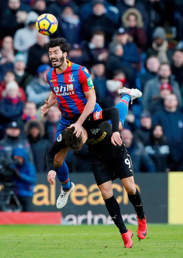 Crystal Palace's James Tomkins in action with Newcastle United's Dwight Gayle. Photo; Reuters/David Klein