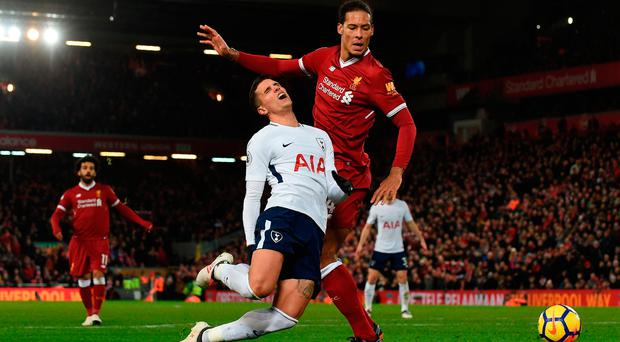 Virgil van Kijk fouls Erik Lamela to gift Tottenham a last-minute penalty at Anfield. Photo: Getty Images