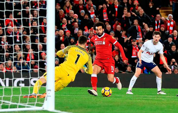 Liverpool's Mohamed Salah scores his side's second goal of the game. Photo credit: Peter Byrne/PA Wire