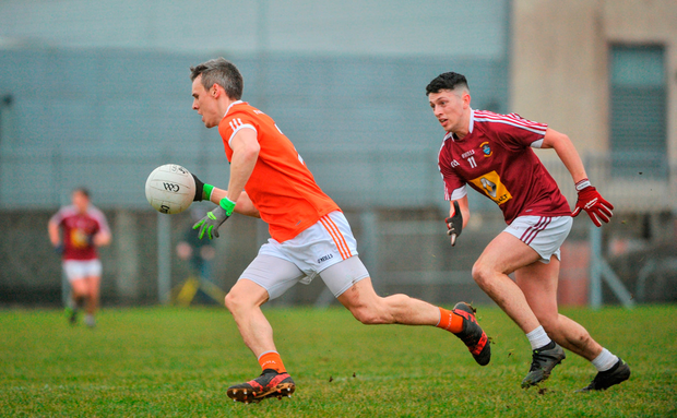 Mark Shields of Armagh in action agaisnt Ronan O'Toole of Westmeath. Photo by Tomás Greally/Sportsfile