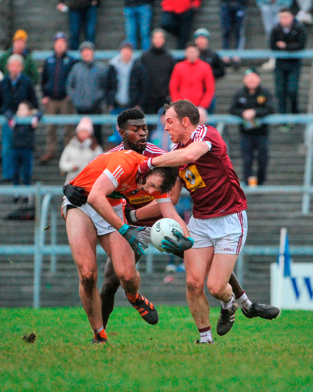 Ethan Rafferty of Armagh in action agaisnt Boidu Sayeh and Frank Boyle of Westmeath. Photo by Tomás Greally/Sportsfile