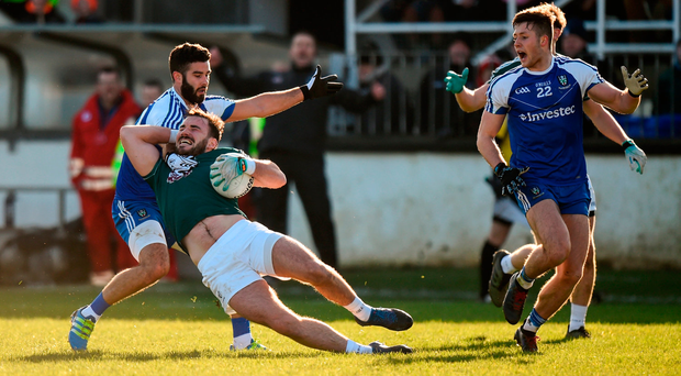 Fergal Conway of Kildare is brought to ground by Monaghan's Neil McAdam in Newbridge. Photo: Sportsfile