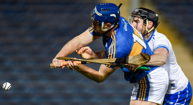 Tipperary's Jason Forde with Waterford's Barry Coughlan. Photo: Sportsfile