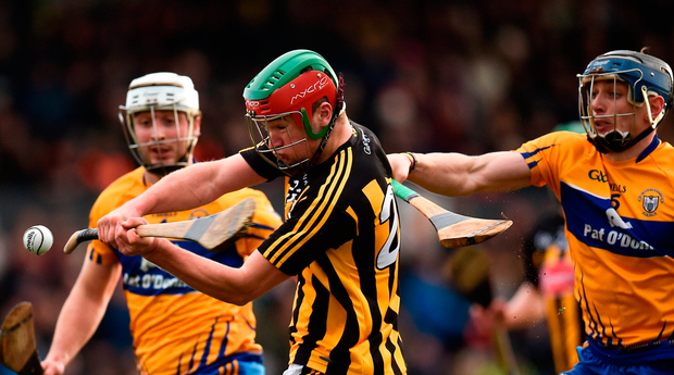 Kilkenny's Pat Lyng scores a point despite pressure from Clare's David McInerney. Photo: Sportsfile