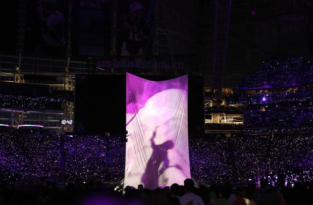 NFL Football - Philadelphia Eagles v New England Patriots - Super Bowl LII Halftime Show - U.S. Bank Stadium, Minneapolis, Minnesota, U.S. - February 4, 2018. Justin Timberlake performs during the halftime show as a projection of the late singer Prince is shown. REUTERS/Chris Wattie
