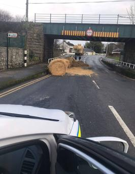 This tractor carrying bales struck a bridge in Cahir last week. Image: An Garda Siochana