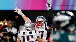 New England Patriots' Rob Gronkowski celebrates scoring a touchdown with Chris Hogan. REUTERS/Chris Wattie